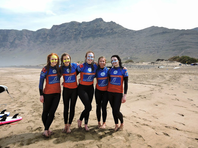 Girls surf Canary Islands